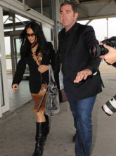 Salma Hayek and Francois-Henry Pinaut airport - Celebrity News - Marie Claire