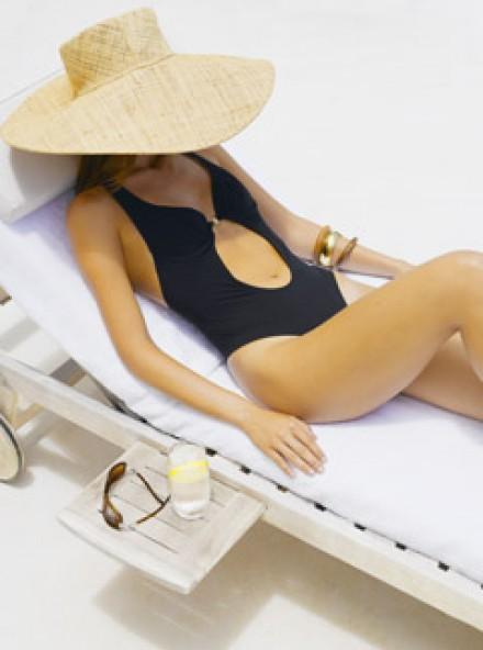 woman sunbathing, health news, marie claire