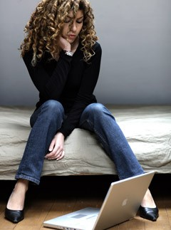 Sad woman with computer, dating, marie claire