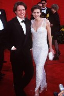 Hugh Grant and Elizabeth Hurley - 50 Best Oscar Dresses - Marie Claire