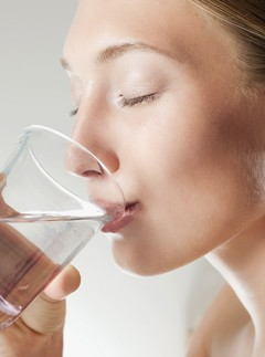 Woman drinks a glass of water - smart morning snacks - health