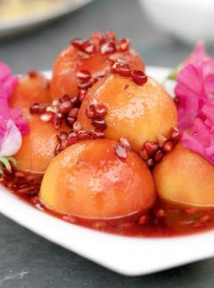 Poached peaches with pomegranate syrup | Marie Claire