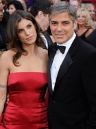 Elisabetta Canalis and George Clooney - George Clooney's girlfriend denies Jennifer Aniston Twitter insult - Celebrity News - Marie Claire