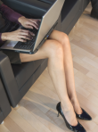 Laptop on lap - working, woman, female, legs, bare, typing, writing, computer, fetaures news, Marie Claire