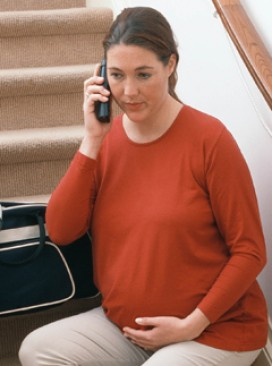 Pregnant woman - on mobile phone