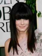 Sandra Bullock debuts new blunt fringe at 2011 Golden Globes