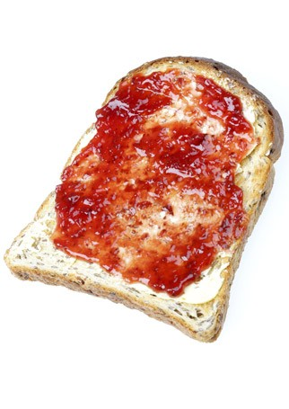 Jam on toast - Piece of brown toast with jam and no butter - 100 Calorie Snacks - Low Calorie Snacks - Marie Claire - Marie Clarie UK