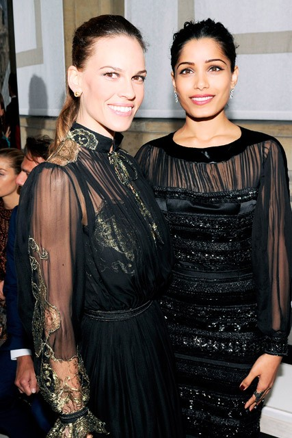 Hilary Swank and Freida Pinto garticle at the Salvatore Ferragamo Cruise Collection fashion show in Paris