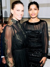 Hilary Swank and Freida Pinto at the Salvatore Ferragamo Cruise Collection fashion show in Paris
