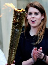 Princess Beatrice greets the Olympic Torch at Harewood House in Leeds