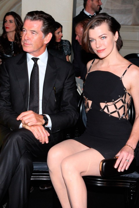 Pierce Brosnan and Milla Jovovich at the Versace Haute Couture Autumn/Winter 2012 show in Paris