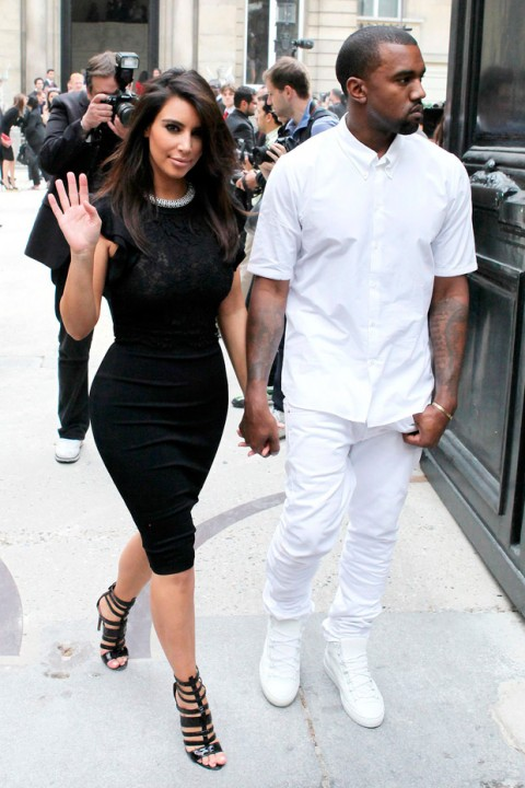 Kim Kardashian and Kanye Wes at the Valentino Haute Couture autumn/winter 2012 show in Paris