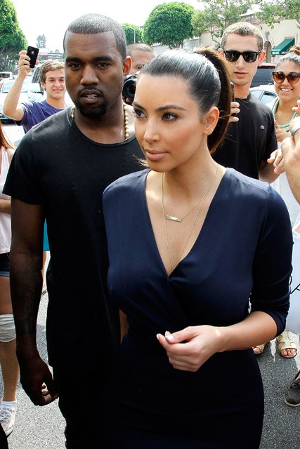 Kanye West and Kim Kardashian at the Dash store launch in Los Angeles