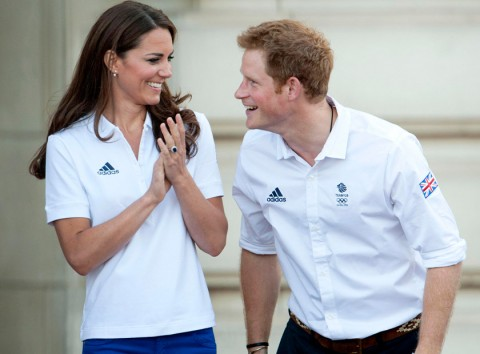 Prince William, Kate Middleton and Prince Harry welcome the Olympic torch to Buckingham Palace