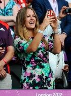 Kim Sears cheers Andy Murray on as he wins an Olympic gold medal in the tennis