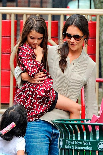 Katie Holmes and Suri Cruise learning to ride a bike