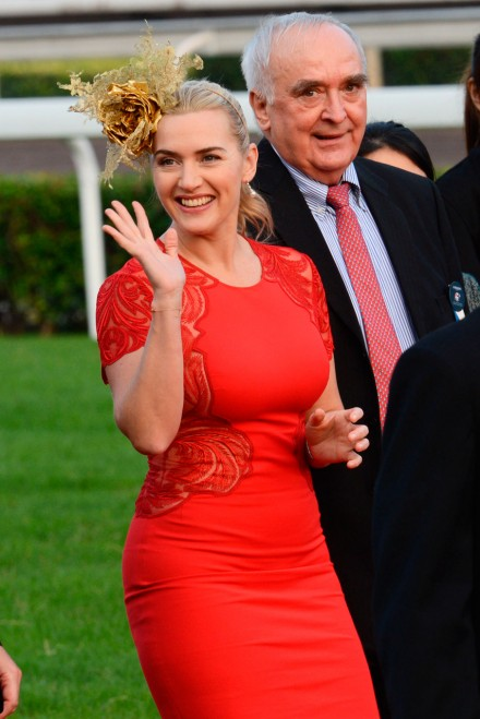 Kate Winslet wearing a red dress and fascinator at the Longines Hong Kong International Races