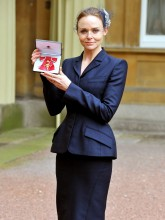 Stella McCartney collects her OBE from the Queen