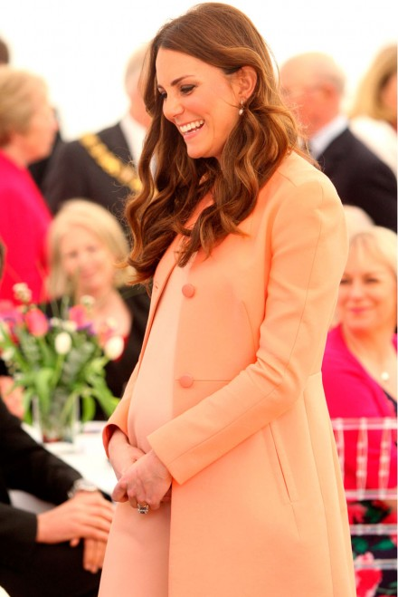 Kate Middleton wearing a coral coat