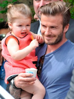David Beckham carries Harper Beckham in London