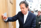 Charles Saatchi arrives at his home after speaking to police