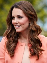 Kate Middleton wearing a peach-coloured coat