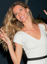 Gisele Bundchen wears white at a showbiz party