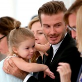 Harper Beckham and David Beckham at NYFW