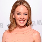 Kylie Minogue wears a pink dress on the red carpet