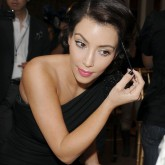 Kim Kardashian applying makeup