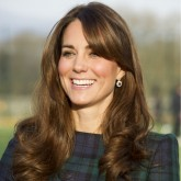 Kate Middleton in a blue and green tartan dress