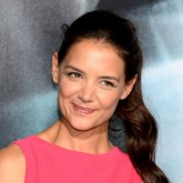 Katie Holmes wears a bright pink dress to a red carpet event