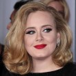 Adele looking gorgeous with high volume hair and a statement red lip