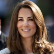 Kate Middleton looks radiant in a white dress with thick tumbling tresses and a rosy glow