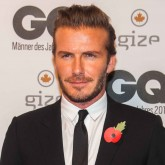 David Beckham smouldering in a sharp black suit at the GQ Awards 2013