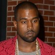 Kanye West out for dinner with Kim Kardashian in a grey tshirt and red blazer