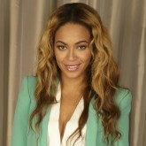 Beyonce wearing a mint green blazer