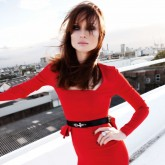 Sophie Ellis Bextor in a bright red midi dress