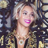 Beyonce wears a gold and black dress for her New Year's celebrations