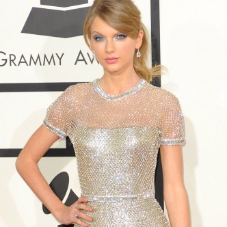 Taylor Swift wearing a Gucci dress to the Grammys 2014
