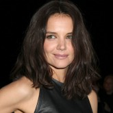 Katie Holmes wears a sexy leather dress at New York Fashion Week.