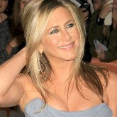 Jennifer Aniston wears a blue dress on the red carpet.