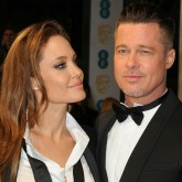 Brad Pitt and Angelina Jolies wear matching tuxedos at the BAFTAs red carpet 2014.