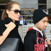 Angelina Jolie, Brad Pitt and Maddox arrive at LAX.