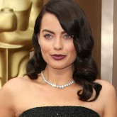 Margot Robbie showed off her dark hair makeover at the Oscars 2014.