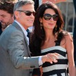 Amal Alamuddin and George Clooney on a boat before getting married in Venice