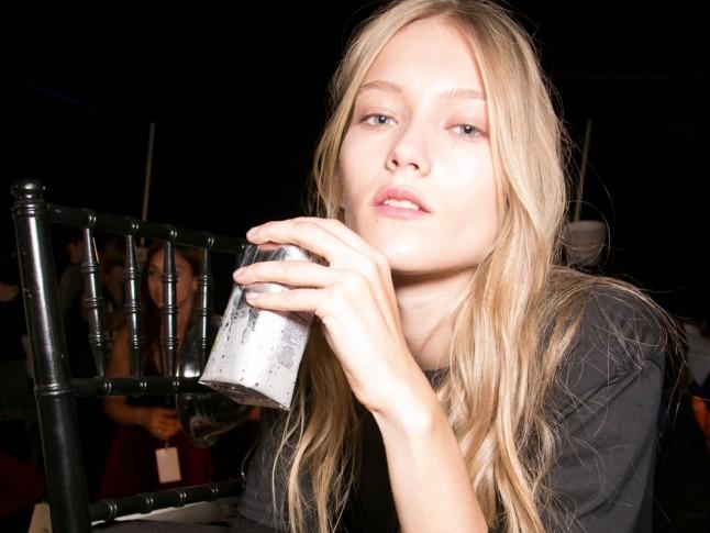 Photo of a model drinking Birch Tree Water