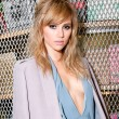Suki Waterhouse with a medium mid length hairstyle
