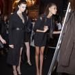 Photo of models looking in The Skinny Mirror