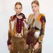 Models rock the 70s fashion trend backstage at the Gucci SS15 fashion show